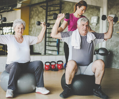 Senior people workout in rehabilitation center. Senior people wi